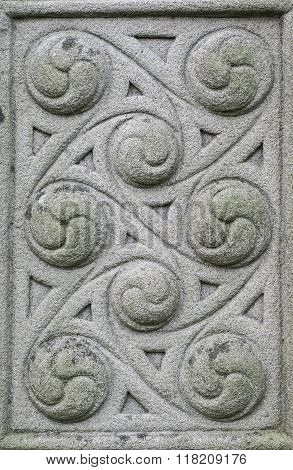 Old stone carved Celtic design background texture detail