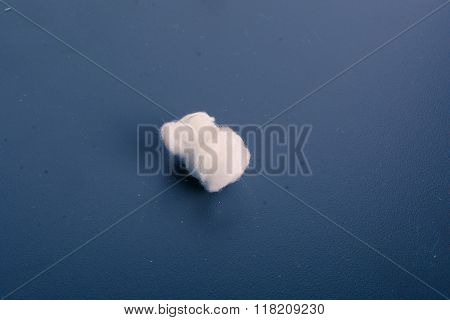 Cotton white ball against a dark background