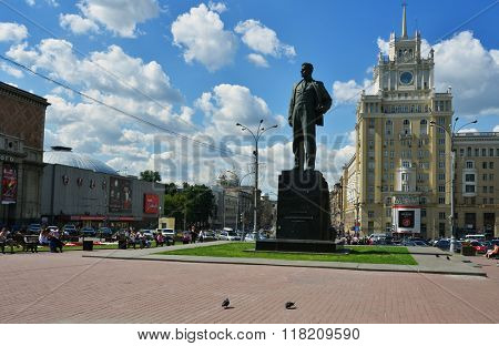 MOSCOW, RUSSIA - JULY 4, 2014: People resting at the monument to Vladimir Mayakovsky against the hotel Peking. The hotel was opened in 1956, and every room here still has its own individual design