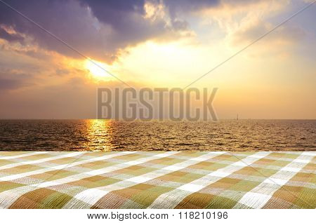 Outdoor Picnic Background With Picnic Table In The Evening Light.
