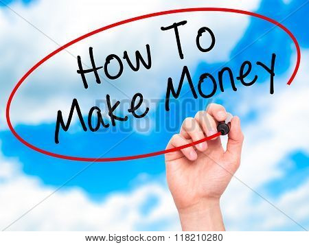 Man Hand Writing How To Make Money With Black Marker On Visual Screen