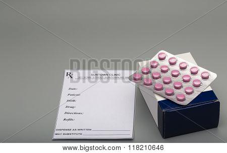 Prescription red pills and blue pill box