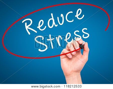 Man Hand Writing Reduce Stress With Black Marker On Visual Screen
