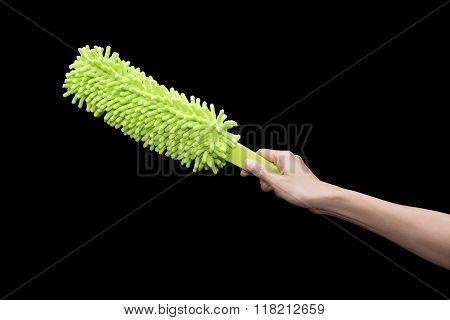 Woman With Duster Cleaning On Black Background