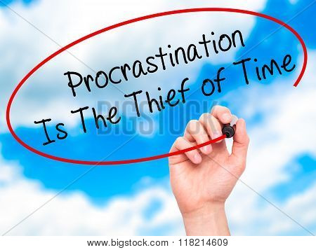 Man Hand Writing  Procrastination Is The Thief Of Time With Black Marker On Visual Screen
