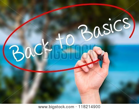 Man Hand Writing Back To Basics Black With Marker On Visual Screen
