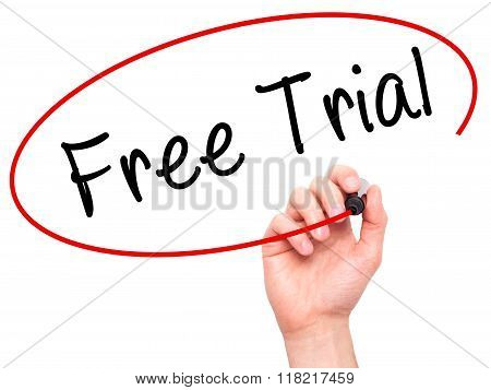 Man Hand Writing Free Trial With Black Marker On Visual Screen