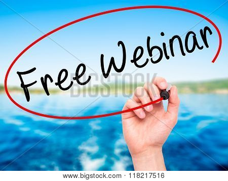 Man Hand Writing  Free Webinar With Black Marker On Visual Screen