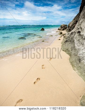 Holiday symbol of quiet rest in attractive areas on the beach, with visible footprints in the sand