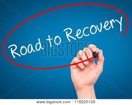 Man Hand Writing Road To Recovery With Black Marker On Visual Screen