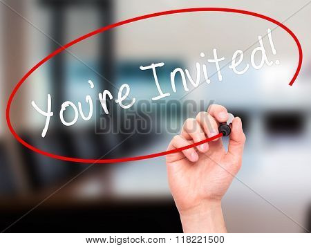 Man Hand Writing You're Invited! With Black Marker On Visual Screen