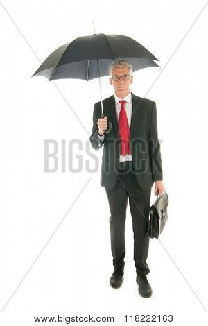 Formally dressed Senior business man with umbrella and case
