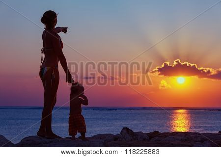 Mother With Son Look At Sunset Sun On The Beach