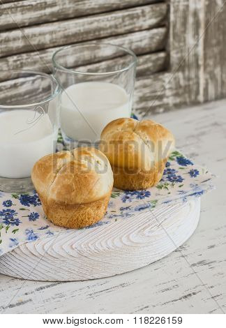 Homemade Brioche Bun And Two Glasses Of Milk On A Light Rustic Wood Background