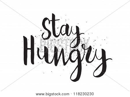 Stay hungry inscription. Greeting card with calligraphy. Hand drawn design. Black and white.