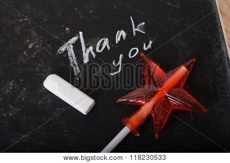 Thank you Space written on a blackboard with chalk, caramel, candy, star, wand, valentines day, swee