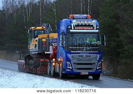 Volvo FH16 Truck Hauls Crawler Excavator