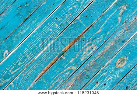Diagonal blue wooden backgroud. Old colored wood board