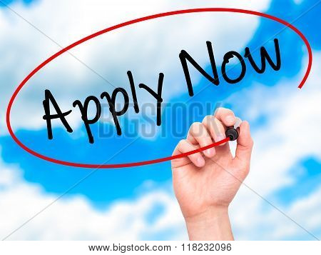 Man Hand Writing Apply Now With Black Marker On Visual Screen