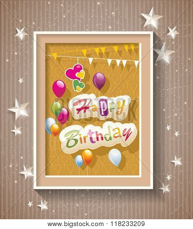 Happy Birthday text in frame on cardboard background