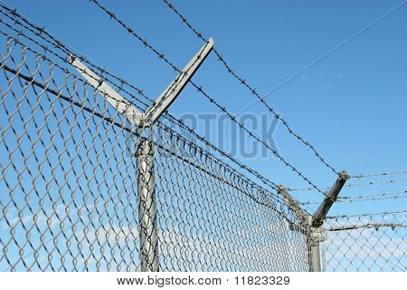 Security fence and barbed wire