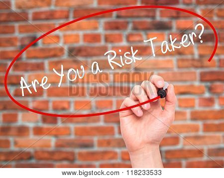Man Hand Writing Are You A Risk Taker? With Black Marker On Visual Screen
