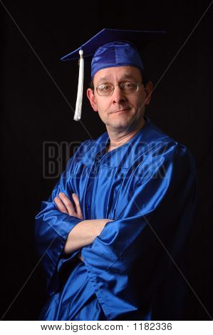 Man With Graduation Gown And Cap