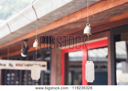 Bell Hang On Wooden Roof