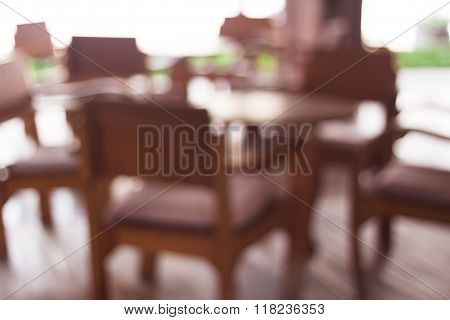 Coffee Shop Blur Backgroun With Wooden Table