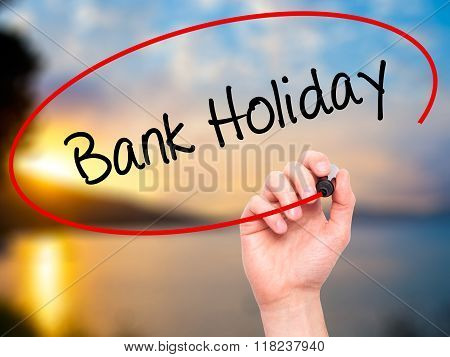 Man Hand Writing Bank Holiday With Black Marker On Visual Screen