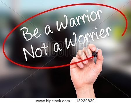 Man Hand Writing Be A Warrior Not A Worrier With Black Marker On Visual Screen
