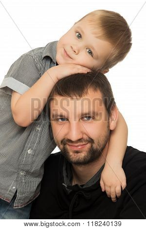 Dad hugging son