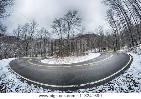 S Curve Road In The Mountains After Winter Snow Storm