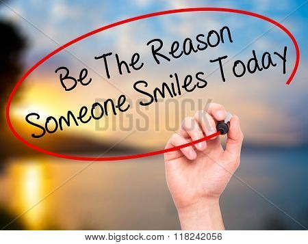 Man Hand Writing Be The Reason Someone Smiles Today  With Black Marker On Visual Screen