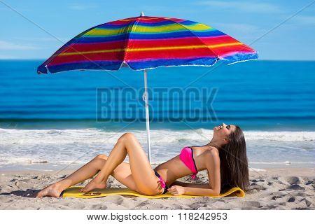 Model sunning on the beach.