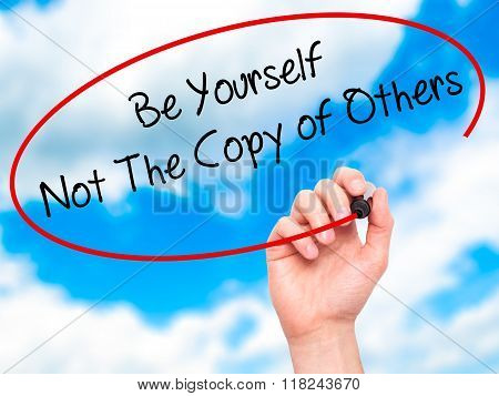 Man Hand Writing Be Yourself Not The Copy Of Others With Black Marker On Visual Screen