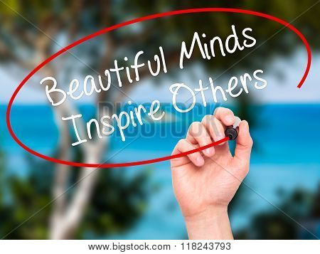 Man Hand Writing Beautiful Minds Inspire Others With Black Marker On Visual Screen