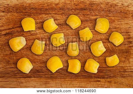 Grains Of Corn On A Wooden Table.