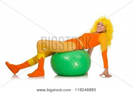 Young girl with swiss ball isolated on white