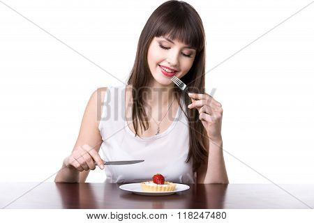 Young Woman Tempted To Eat Cake