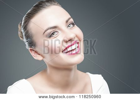 Emotions Concept. Closeup Portrait Of Happy Smiling Caucasian Brunette Woman Posing Against Gray