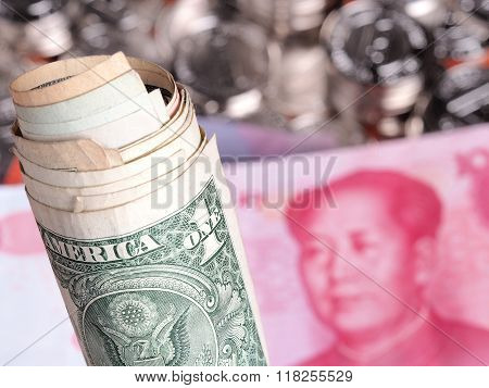 Roll Of Us Dollar Money In Front Of  Chinese Yuan
