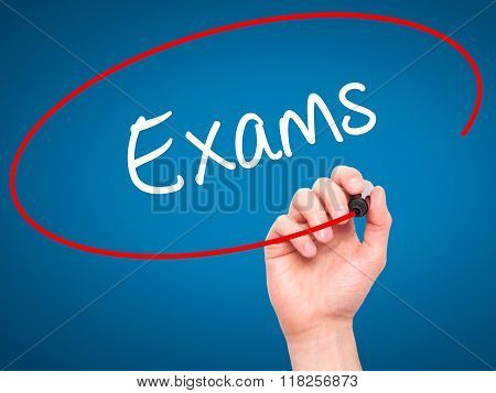 Man Hand Writing Exams With Black Marker On Visual Screen