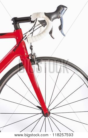 Cycling Sport Concept. Professional Road Bike Front Wheel And Handlebars Closeup. Against White Back