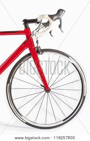 Cycling Sport Concept. Professional Road Bike Front Wheel And Handlebars Closeup. Against White