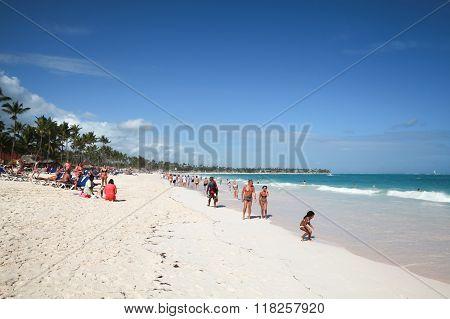 Tourists Walk Along Beach Of Punta Cana Resort
