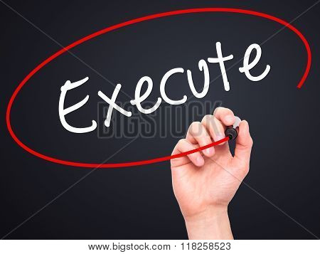 Man Hand Writing Execute With Black Marker On Visual Screen