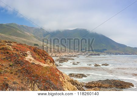 Travel Concepts And Ideas. The Range Of Cloudy Mountains And Amazing View Of Pacific Coastline