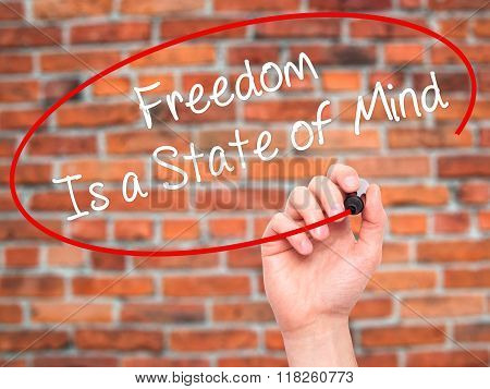 Man Hand Writing Freedom Is A State Of Mind With Black Marker On Visual Screen