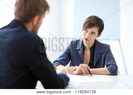 Business Partners Discussing Documents And Ideas In The Office